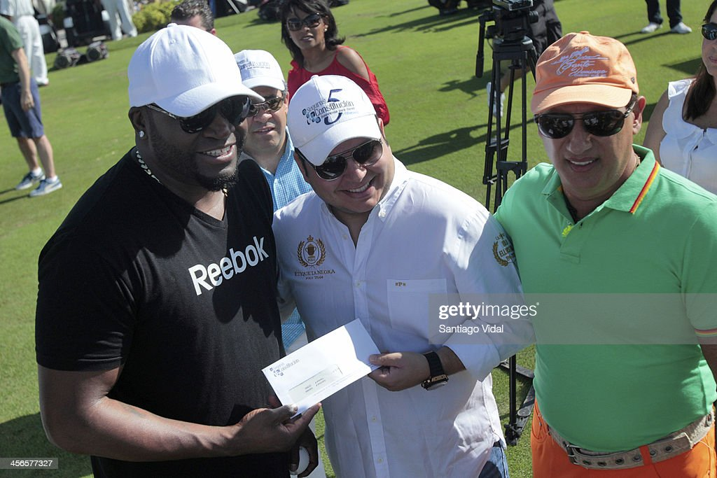 World Series Champion & MVP David Ortiz receives a donor check for his foundation during the David Ortiz 6th Celebrity Golf Classic at Punta Espada Golf Club on December 14, 2013 in Punta Cana, Dominican Republic.