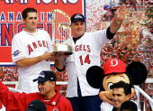 World Series Most Valuable Player Troy Glaus of the Anaheim Angels and team manager Mike Scioscia wave to fans during a victory parade down 'Main...