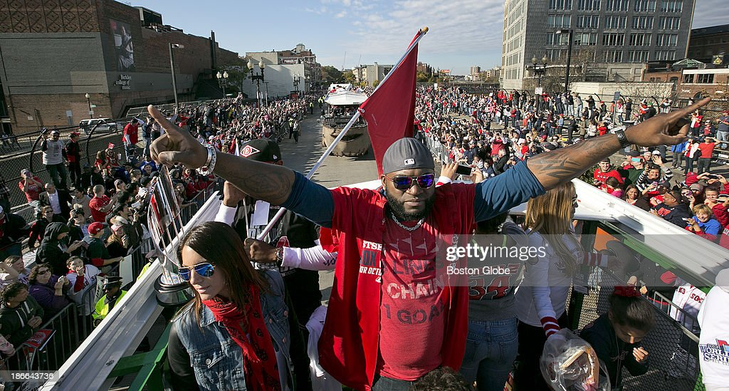 World Series MVP David Ortiz and his wife Tiffany, left, atop a Duck Boat on Boylston Street during the Red Sox's 2013 World Series Rolling Rally victory parade in Boston on Saturday, Nov. 2, 2013.