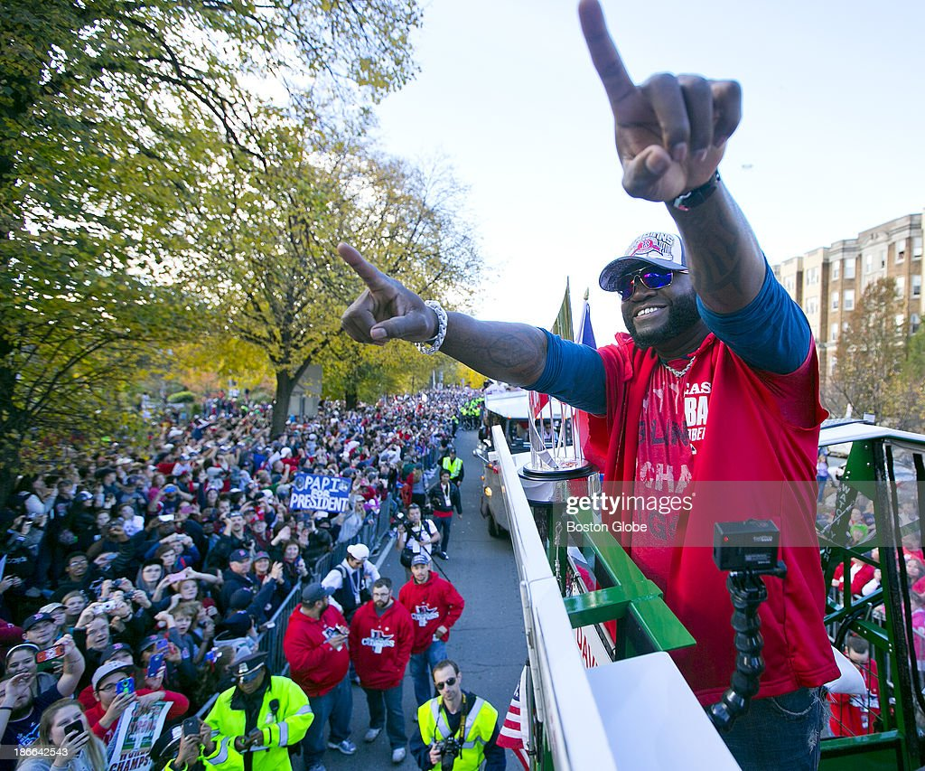 World Series MVP David Ortiz gestures to the crowd from a Duck Boat at the start of the Red Sox's 2013 World Series Rolling Rally victory parade in Boston on Saturday, Nov. 2, 2013.