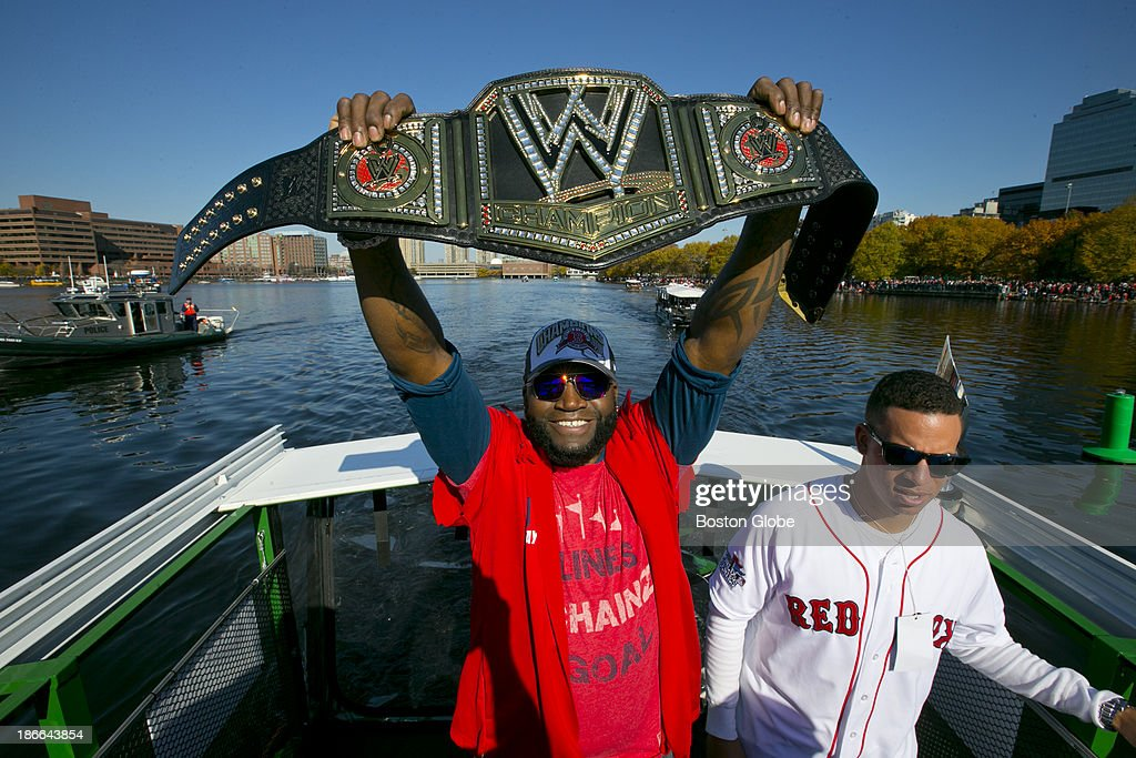World Series MVP David Ortiz hoists a champion belt as the Duck Boat he is riding goes down the Charles River during the Red Sox's 2013 World Series Rolling Rally victory parade in Boston on Saturday, Nov. 2, 2013.