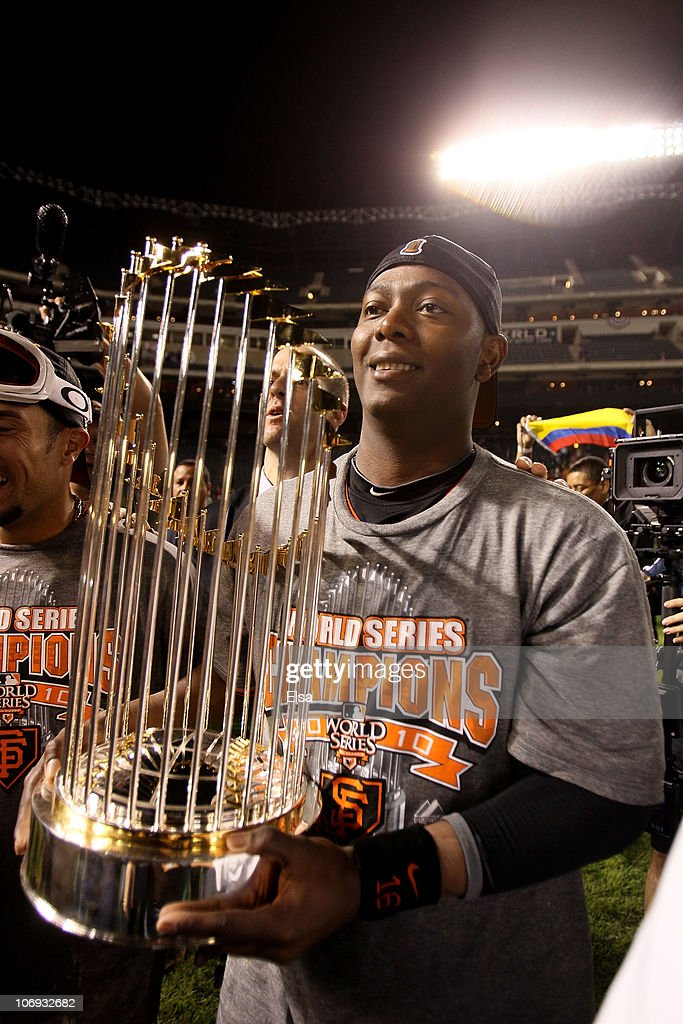 World Series MVP <a gi-track='captionPersonalityLinkClicked' href=/galleries/search?phrase=Edgar+Renteria&family=editorial&specificpeople=167133 ng-click='$event.stopPropagation()'>Edgar Renteria</a> #16 of the San Francisco Giants celebrates on the field with the World Series Championship trophy after the Giants won 3-1 against the Texas Rangers in Game Five of the 2010 MLB World Series at Rangers Ballpark in Arlington on November 1, 2010 in Arlington, Texas.