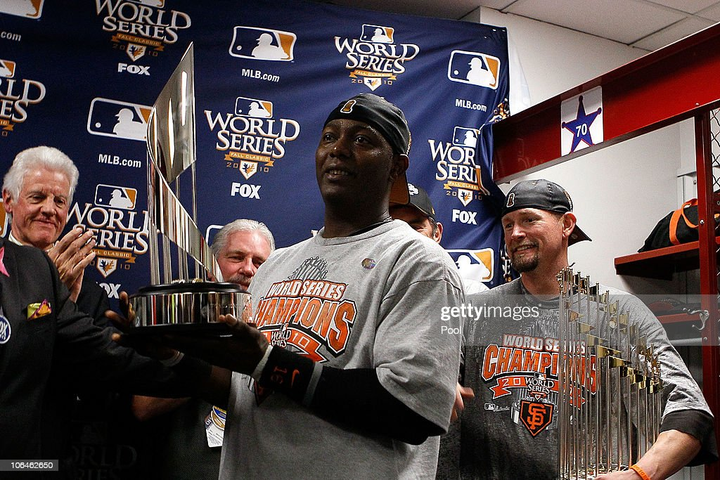 World Series MVP <a gi-track='captionPersonalityLinkClicked' href=/galleries/search?phrase=Edgar+Renteria&family=editorial&specificpeople=167133 ng-click='$event.stopPropagation()'>Edgar Renteria</a> of the San Francisco Giants receives his MVP trophy in the locker room after the Giants won 3-1 against the Texas Rangers in Game Five of the 2010 MLB World Series at Rangers Ballpark in Arlington on November 1, 2010 in Arlington, Texas. The Giants won the series 4-1.