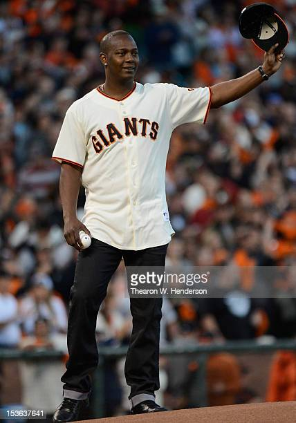 World Series MVP Edgar Renteria waves to the crowd before throwing out the ceremonial first pitch of Game Two of the National League Division Series...