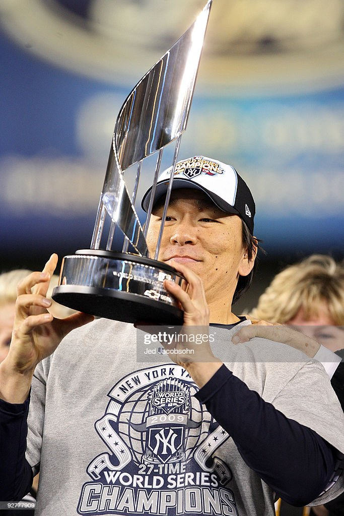 World Series MVP <a gi-track='captionPersonalityLinkClicked' href=/galleries/search?phrase=Hideki+Matsui&family=editorial&specificpeople=157483 ng-click='$event.stopPropagation()'>Hideki Matsui</a> #55 of the New York Yankees celebrates with the MVP trophy after their 7-3 win against the Philadelphia Phillies in Game Six of the 2009 MLB World Series at Yankee Stadium on November 4, 2009 in the Bronx borough of New York City.