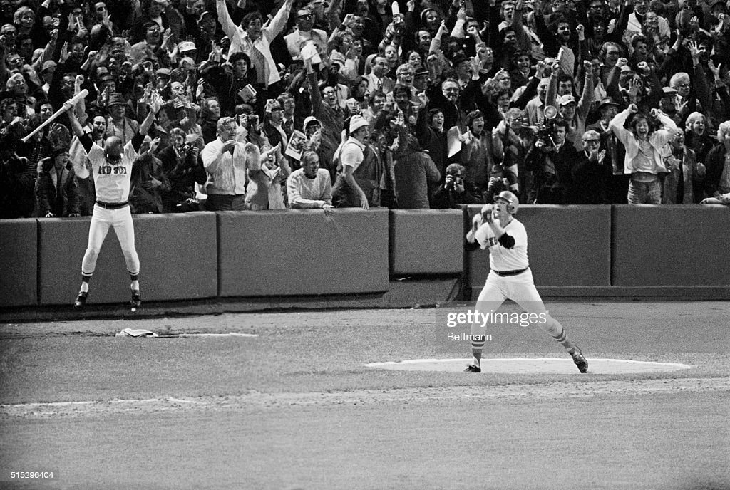 Carlton Fisk of the Red Sox jumps with joy after hitting the game winning home run in the 12th inning. The Red Sox winning 7-6 and making it three games a piece. Fred Lynn also shows his joy, L.