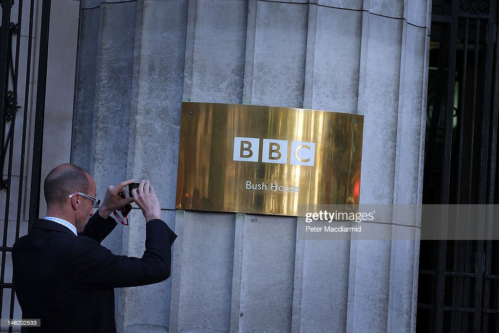 World Service employee takes a photograph of the sign at the front of Bush House on July 12, 2012 in London, England. Today the last ever news bulletin was read from Bush House - home to World Service radio for 70 years. The station is now based in a new building at Broadcasting House one mile away.