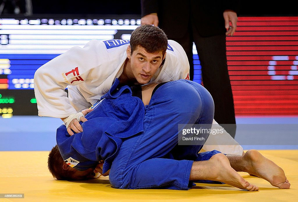 World silver medallist, <a gi-track='captionPersonalityLinkClicked' href=/galleries/search?phrase=Avtandil+Tchrikishvili&family=editorial&specificpeople=8082760 ng-click='$event.stopPropagation()'>Avtandil Tchrikishvili</a> of Georgia (white), narrowly defeated Alexander Wieczerzak of Germany by a shido penalty on his way to the u81kg semi-final during the Montpellier European Judo Championships at the Park&Suites Arena on April 25, 2014 in Perols, Montpellier, France.