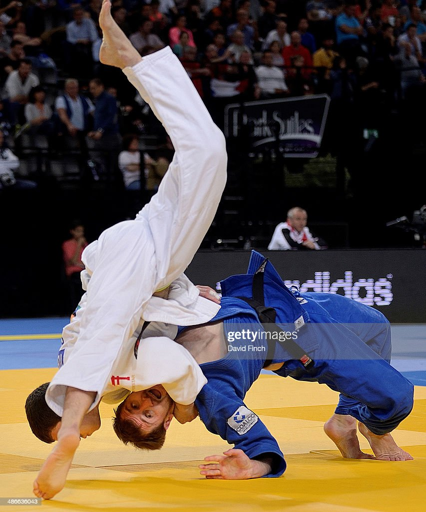 World silver medallist, <a gi-track='captionPersonalityLinkClicked' href=/galleries/search?phrase=Avtandil+Tchrikishvili&family=editorial&specificpeople=8082760 ng-click='$event.stopPropagation()'>Avtandil Tchrikishvili</a> of Georgia (white), throws Sirazhudin Magomedov of Russia for an ippon (10 points) on his way to the u81kg semi-final during the Montpellier European Judo Championships at the Park&Suites Arena on April 25, 2014 in Perols, Montpellier, France.