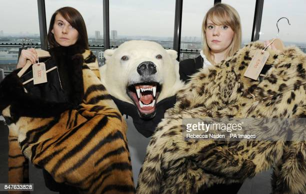 World Society for the Protection of Animals campaign fund raisers Margaret Balaskas holding a Tiger skin coat and Anna Reaich holding a Snow Leopard...