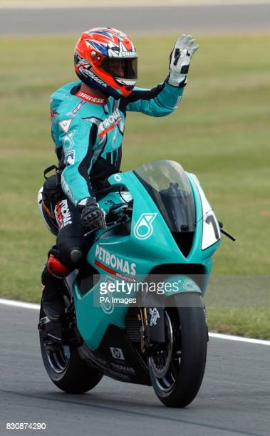 World Super bikes Championship at Brands Hatch Kent UK Fromer World Champion and now team manager Carl Fogerty does a lap for the fans to show off...