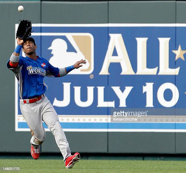 World Team right fielder Oscar Taveras makes a catch in the sixth inning during of the AllStar Futures baseball game at Kauffman Stadium in Kansas...