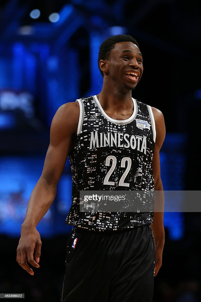 World Team's <a gi-track='captionPersonalityLinkClicked' href=/galleries/search?phrase=Andrew+Wiggins&family=editorial&specificpeople=7720937 ng-click='$event.stopPropagation()'>Andrew Wiggins</a> #22 of the Minnesota Timberwolves smiles on the court during the BBVA Compass Rising Stars Challenge as part of the 2015 NBA Allstar Weekend at the Barclays Center on February 13, 2015 in the Brooklyn borough of New York City.