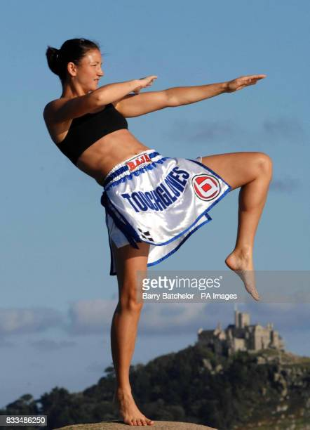 World Thai kickboxing champion Julie Kitchen aged 30 on the beach at Long Rock near Penzance Cornwall