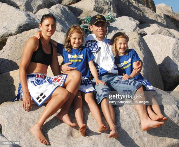 World Thai kickboxing champion Julie Kitchen aged 30 with her eight year old twin daughters Allaya and Amber on the beach at Long Rock near Penzance...
