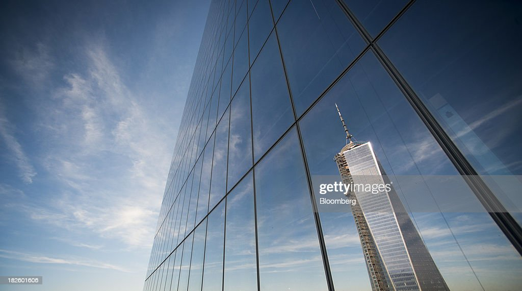 1 World Trade Center is reflected in the window of the 4 World Trade Center building, managed by Silverstein Properties Inc., in New York, U.S., on Wednesday, Sept. 25, 2013. Real estate developer Larry Silverstein cant recoup any of the $1.2 billion recovered by World Trade Center insurers in settlements with airlines and airport security companies over the Sept. 11, 2001, terrorist attack that destroyed the office complex, a judge ruled. Photographer: Craig Warga/Bloomberg via Getty Images