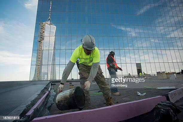1 World Trade Center stands as contractors waterproof the 48th floor of the 4 World Trade Center building managed by Silverstein Properties Inc in...