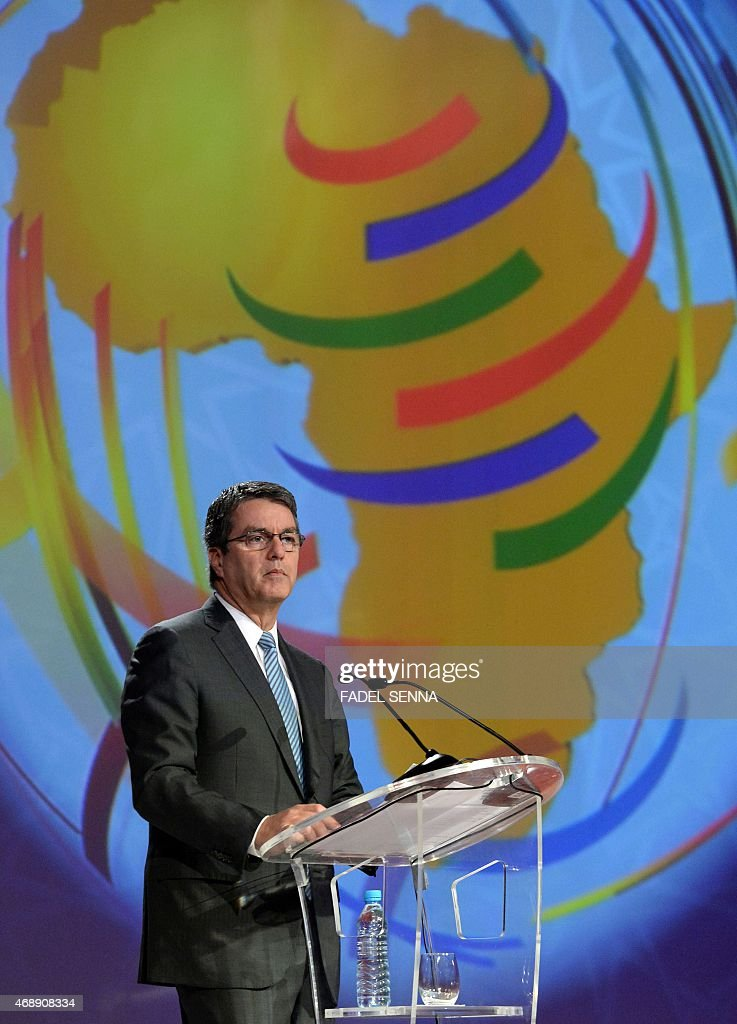 World Trade Organisation (WTO) Director General, Roberto Azevedo, delivers a speech during a ceremony marking the 20th anniversary of the WTO in the Moroccan city of Marrakesh where it was created, on april 8, 2015. AFP PHOTO / FADEL SENNA