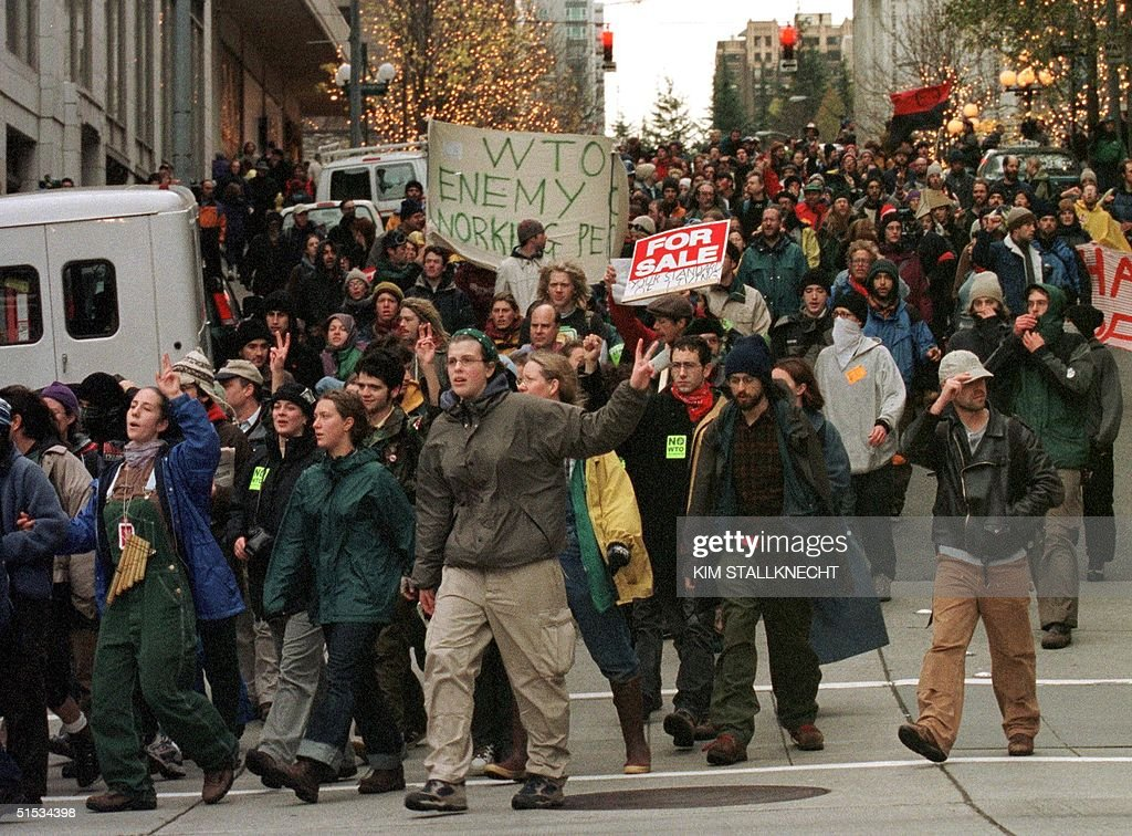 World Trade Organization protesters march through downtown Seattle Washington 1999 Hundreds of demonstrators were arrested during the second day of...