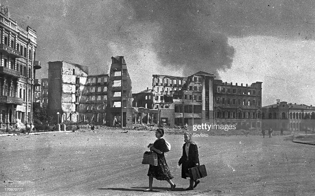 World war 2 battle of stalingrad two women heading for safer ground while bombs drop on stalingrad