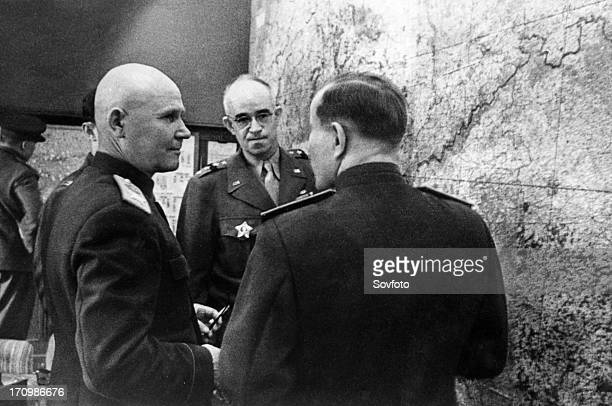 World war 2 marshal of the soviet union ivan konev commander of the troops of the first ukrainian front confering with american general omar bradley...