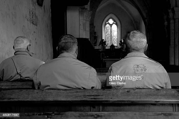 World War 2 reenactors sit inside Angloville Au Plain church near Carentan Normandy June 4 2014 in Normandy France It was in this church that two US...