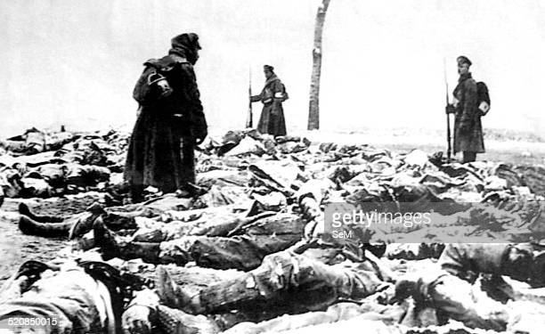 World War I 1914 1917 Russian front after the battle The terrifying aspect of the battlefield covered with dead bodies while a Russian soldier...