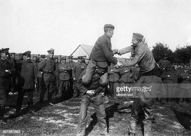 German army sports meeting in the back area soldiers in a contest undated probably in 1915/1916