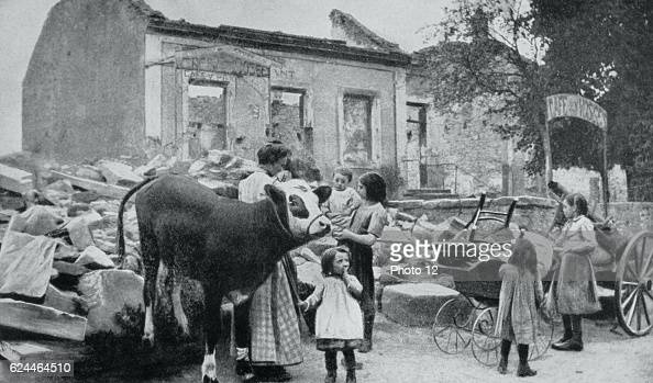 French villagers returning to their devastated village after the retreat of German forces From 'Le Flambeau' Paris September 1915 Women Children Ruins