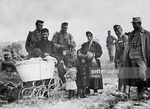 World War I Galician Jew with his wife and five children one in a baby carriage fleeing from the tsaristic army next to five AustrianHungarian...