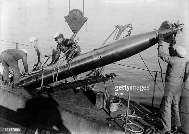 World War I Placing a torpedo in the torpedo tube of an American submarine K5