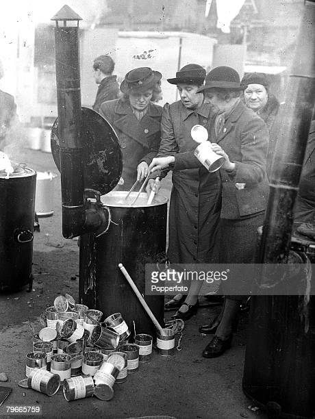 World War II 12th April 1941 Womens voluntary service ladies preparing food for bombed out homeless people on mobile kitchens in bomb ravaged Coventry