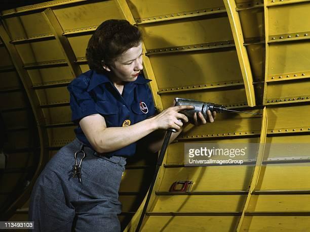 World War II 19391945 Woman working on a Vengeance dive bomber using a hand drill VulteeNashville Tennessee USA 1943 Labour Female War Effort