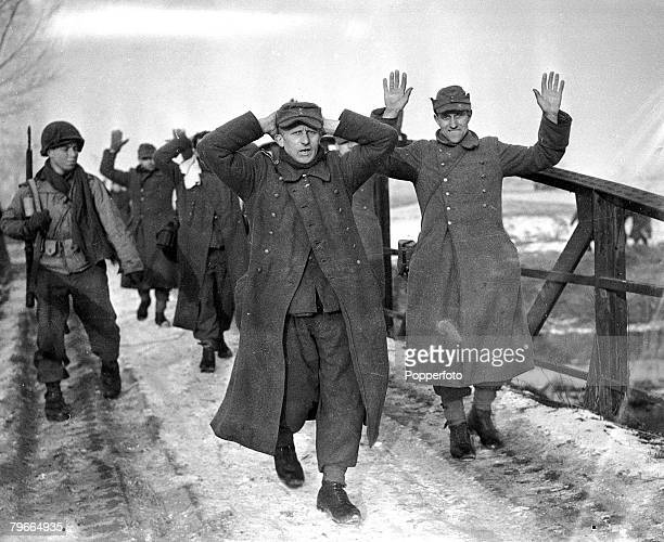 World War II 20th January 1945 Germans captured near Gambsheim are marched to the rear during the battle for Strasbourg and at least one Nazi looks...