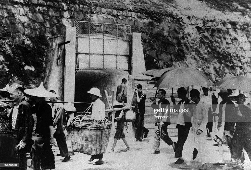 World War II, 23rd December 1941, Hong Kong, Asia, The entrance to a tunnel air-raid shelter, drilled into a solid rock hill, The British Crown Colony has already been bombed by Japanese warplanes flying across from Kowloon