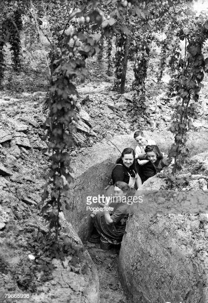 World War II 27th August 1940 Kent England Young East End hop pickers shelter in a slit trench during a daylight air raid