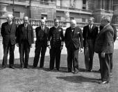 World War II 4th August 1944 King George VI pictured in the grounds of Buckingham Palace with his second World War cabinet Lto R Lord Woolton Sir...