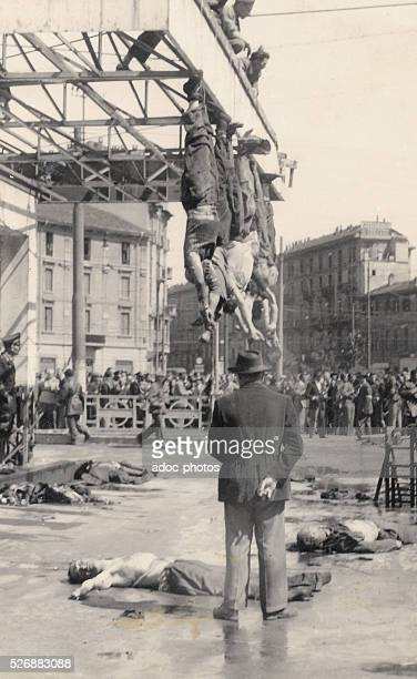 World War II Benito Mussolini and his mistress Claretta Petacci hung by their feet in Piazzale Loreto in Milan On April 1945