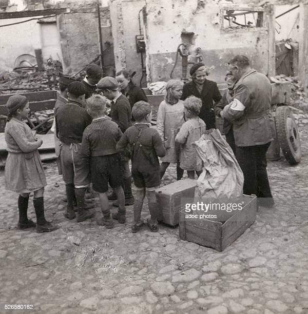 World War II Distribution of food aid to the people of Ostheim In 1945