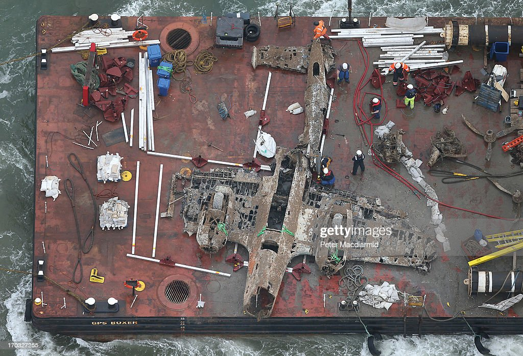 A World War II Dornier 17 aircraft is transported on a barge to harbour on June 11, 2013 near Ramsgate, England. The salvage operation, planned through the RAF Museum, lifted the only remaining German bomber Dornier 17, used during the 'Battle of Britain' of 1940 from the sea on June 10, 2013.. The plane is believed to be aircraft call-sign 5K-AR, shot down on August 26, 1940 at the height of the battle by RAF Boulton-Paul Defiant fighters. The aircraft will be preserved and put on display for the public at the museum's Hendon base in north London.