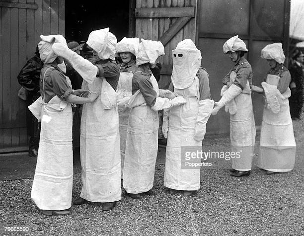 World War II England Girls wear asbestos clothing at a Paper bag factory during an ARP exercises