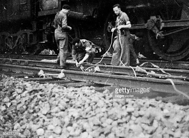 World War II French Resistance fighters sabotaging the MarseilleParis railway in Romanèche on August 30 1944