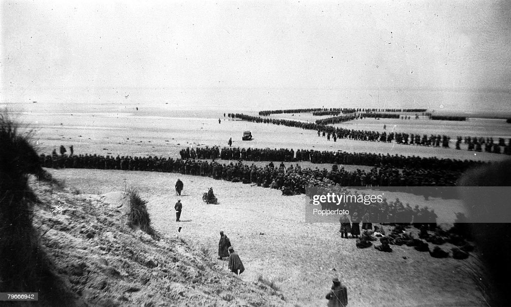 World War II, June 1940, Dunkirk, France, This picture shows the evacuation of Dunkirk, as British troops on a beach form into long winding queues ready to take their turn to board small boats to take them to larger vessels