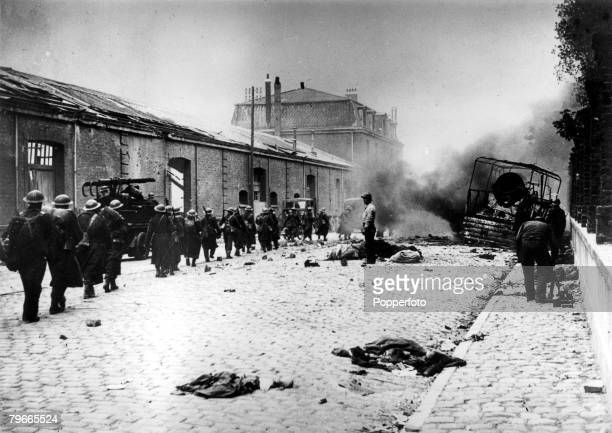 World War II Nazi Invasion of France Dunkirk 6th June 1940 British soldiers march through a debris littered street of Dunkirk during the bombardment...