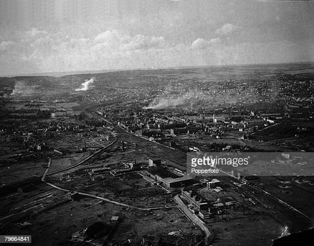 World War II Overview of the German city of Aachen after attacks by Allied bombers on the city the picture showing fires burning in the city and bomb...