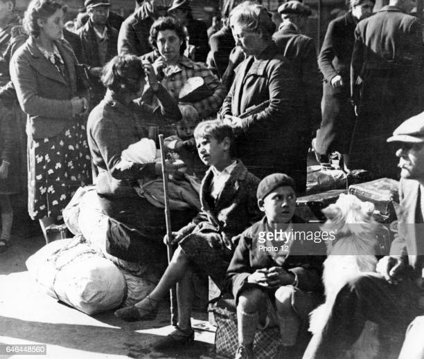 Paris July 1940 Belgian refugee families waiting at the Gare du Nord to be repatriated By this time Paris was under German occupation
