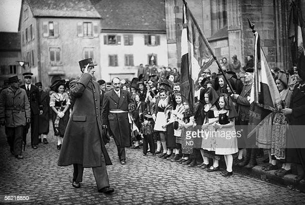 World War II The general de Gaulle greeting the flags during an inspection in Rouffach on Febuary 1945 during the German offensive in the Ardennes...