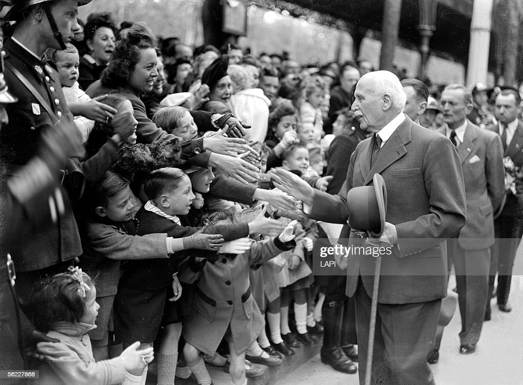 World War II. The marshal Petain greeting the crowd before leaving for the North zone. Vichy, May, 1944.