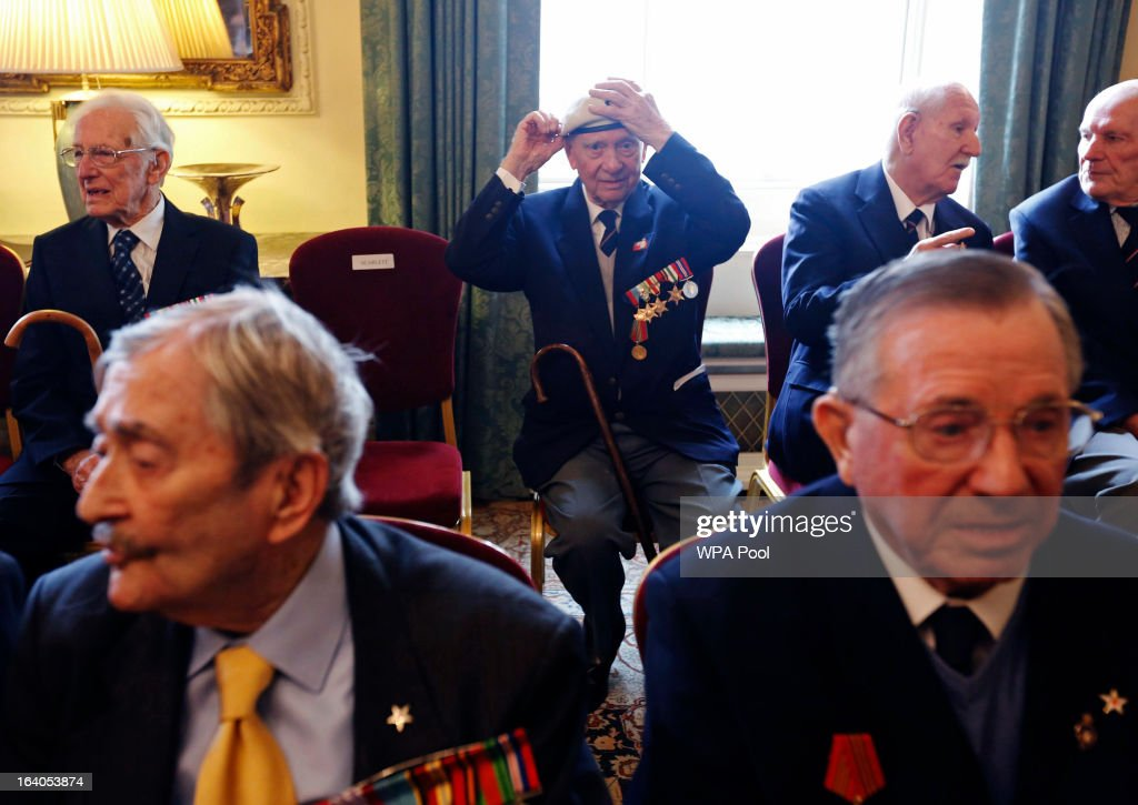 A World War II veteran adjusts his beret before the Arctic Star medal presentation by Britain's Prime Minister David Cameron at Number 10 Downing Street on March 19, 2013 in London, England. The PM today presented two newly created medals, 68 years after the Second World War ended.
