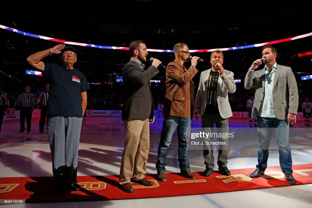 World War II Veteran and Military Hero Harvey Mittleman salutes while the national anthems are sung by the First Baptist Singers of Fort Lauderdale prior to the Florida Panthers hosting the Calgary Flames at the BB&T Center on February 24, 2017 in Sunrise, Florida.